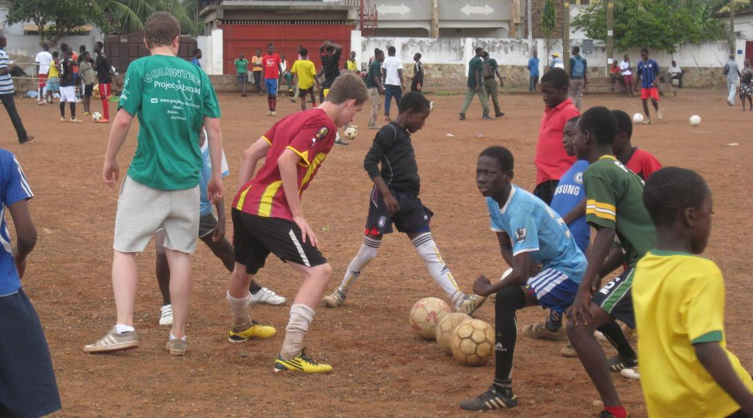 High School Football Coaching volunteers prepare a training session in Ghana with Projects Abroad.